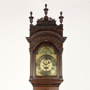 Detail of an eight-day clock, movement by Peter Stretch and case carved by Samuel Harding