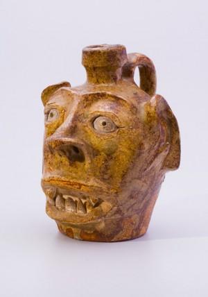 Alkaline-glaze stoneware face jug, ca. 1855-1865
